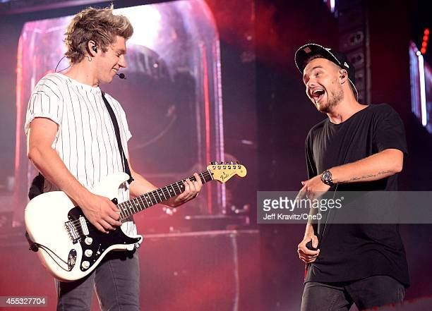 Singers Niall Horan and Liam Payne of One Direction perform onstage during the One Direction' Where We Are' Tour at Rose Bowl on September 11 2014 in...