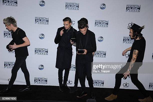 Singers Niall Horan Liam Payne Zayn Malik Louis Tomlinson and Harry Styles of One Direction winners of Artist of the Year Favorite Pop/Rock...