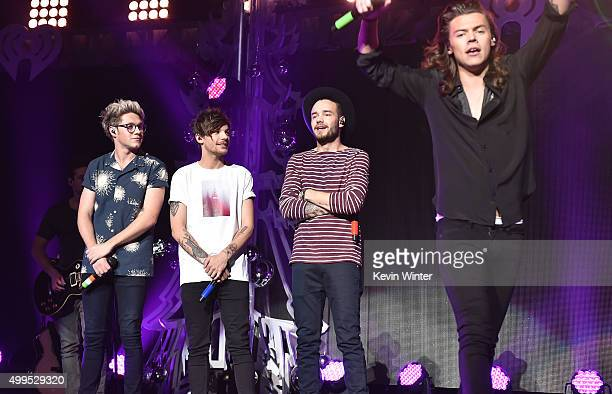 Singers Niall Horan Louis Tomlinson Liam Payne and Harry Styles of musical group One Direction performs onstage during 1061 KISS FM's Jingle Ball...