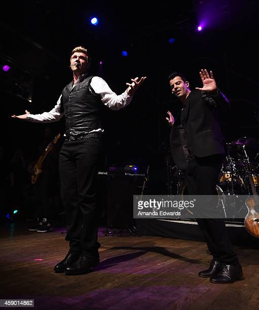 Singers Nick Carter and Jordan Knight of Nick Knight perform onstage at the House of Blues on November 14 2014 in West Hollywood California