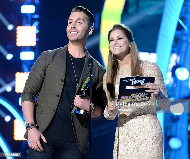 Singers Nick Fradiani and Cassadee Pope speak onstage during the 2015 CMT Music awards at the Bridgestone Arena on June 10 2015 in Nashville Tennessee