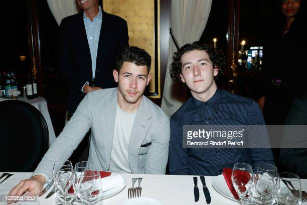 Singers Nick Jonas and Frankie Jonas attend 'Ryder Cup Dinner' at Fouquet's Barriere on September 24 2018 in Paris France