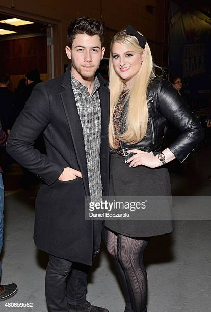 Singers Nick Jonas and Meghan Trainor attend 1035 KISS FM's Jingle Ball 2014 at Allstate Arena on December 18 2014 in Chicago Illinois