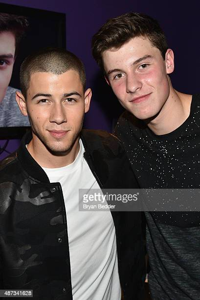 Singers Nick Jonas and Shawn Mendes pose backstage during the Island Records and Marriott Rewards presentation of ISLAND LIFE featuring Nick Jonas...