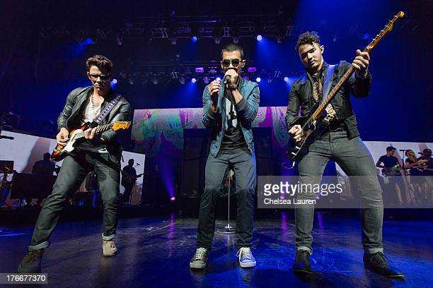 Singers Nick Jonas Joe Jonas and Kevin Jonas of The Jonas Brothers perform at Gibson Amphitheatre on August 16 2013 in Universal City California