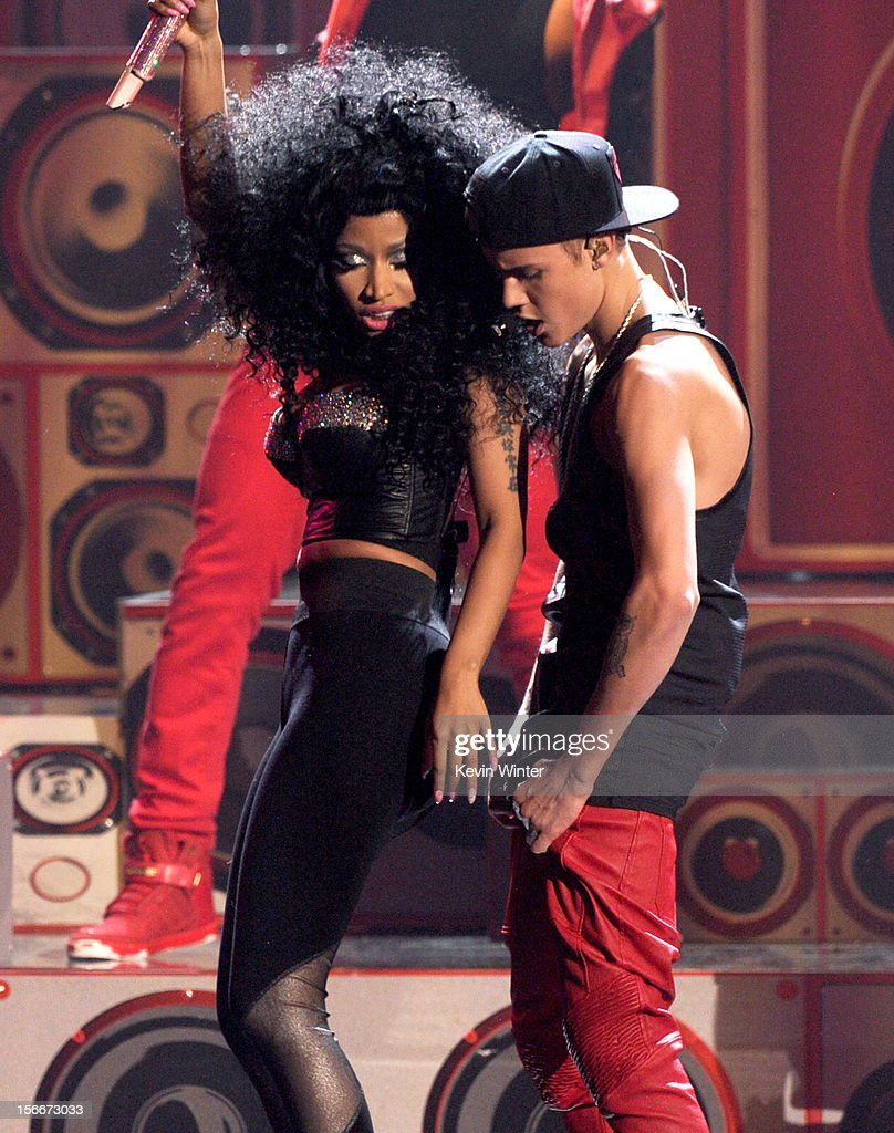 Singers Nicki Minaj (L) and Justin Bieber perform onstage during the 40th American Music Awards held at Nokia Theatre L.A. Live on November 18, 2012 in Los Angeles, California.
