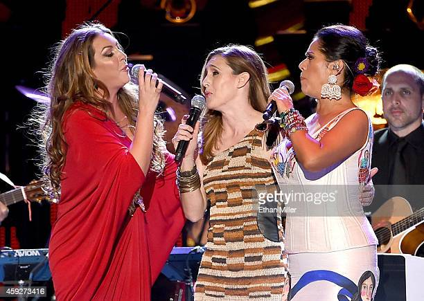 Singers Nina Pastori Soledad and Lila Downs perform onstage during the 2014 Person of the Year honoring Joan Manuel Serrat at the Mandalay Bay Events...