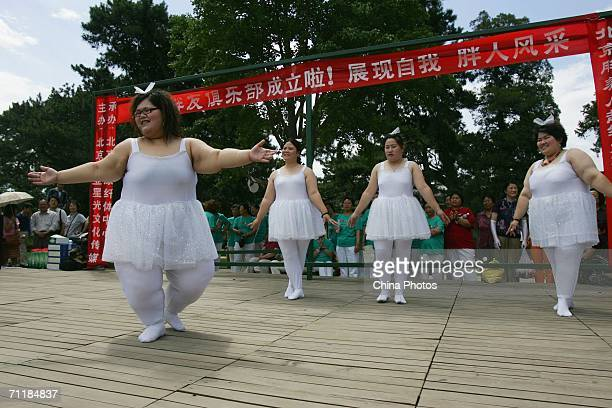 Singers of a obese girl band named 'Qianjin' dance at the opening ceremony of a club for obese people on June 10 2006 in Beijing China The four girls...