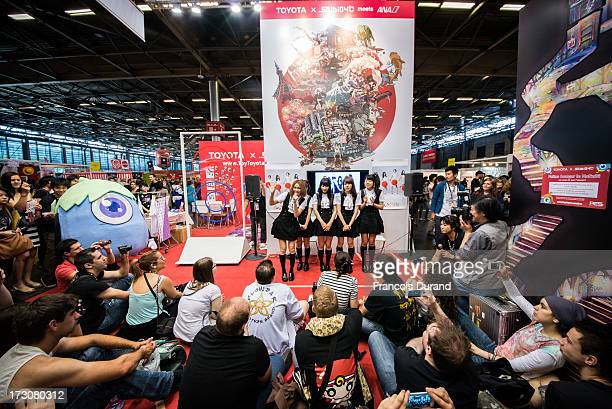 Singers of Aop band attend a talk event at the 'TOYOTA x STUDIO4AC meets ANA PES' booth during the Japan Expo at Paris-nord Villepinte Exhibition...