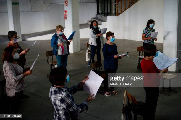 Singers of the Apostol Santiago choir keep their social distance as they attend their first rehearsal after the loosening of a national lockdown to...