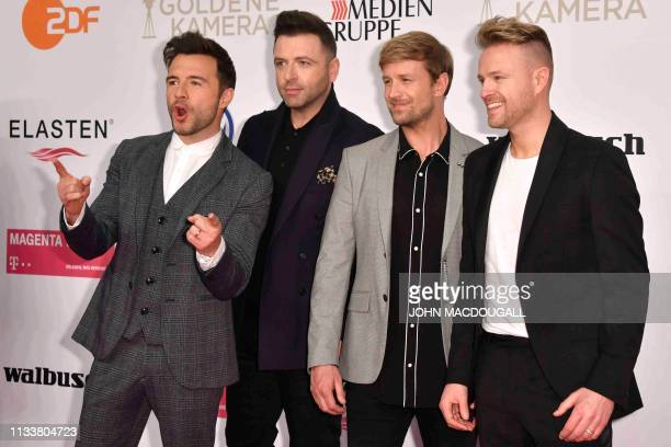 Singers of the boysband Westlife pose on the red carpet as they arrive at the Golden Camera awards ceremony in Berlin on March 30, 2019. - The award...