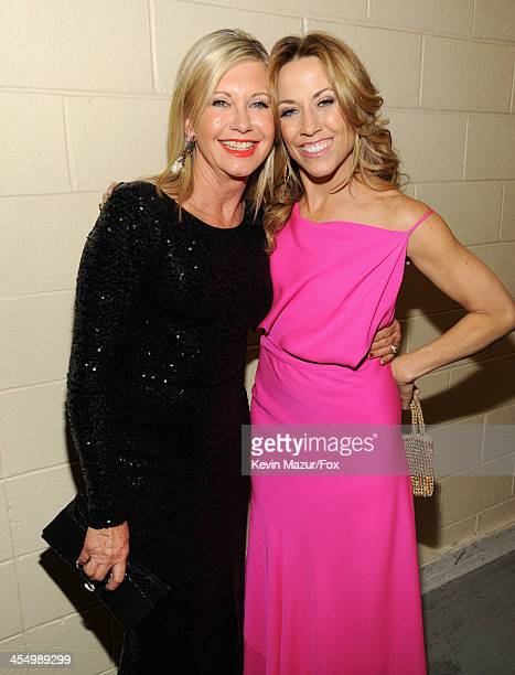 Singers Olivia Newton-John and Sheryl Crow attend the American Country Awards 2013 at the Mandalay Bay Events Center on December 10, 2013 in Las...