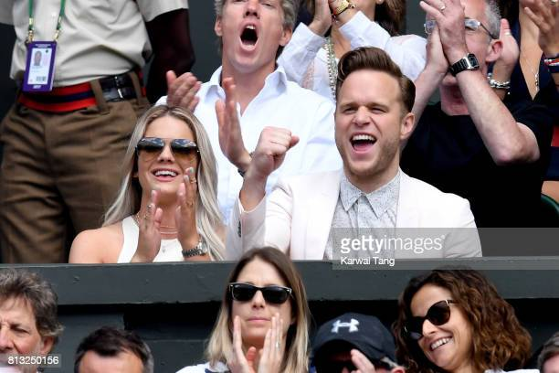 Singers Olly Murs and Louisa Johnson attend day nine of the Wimbledon Tennis Championships at the All England Lawn Tennis and Croquet Club on July...