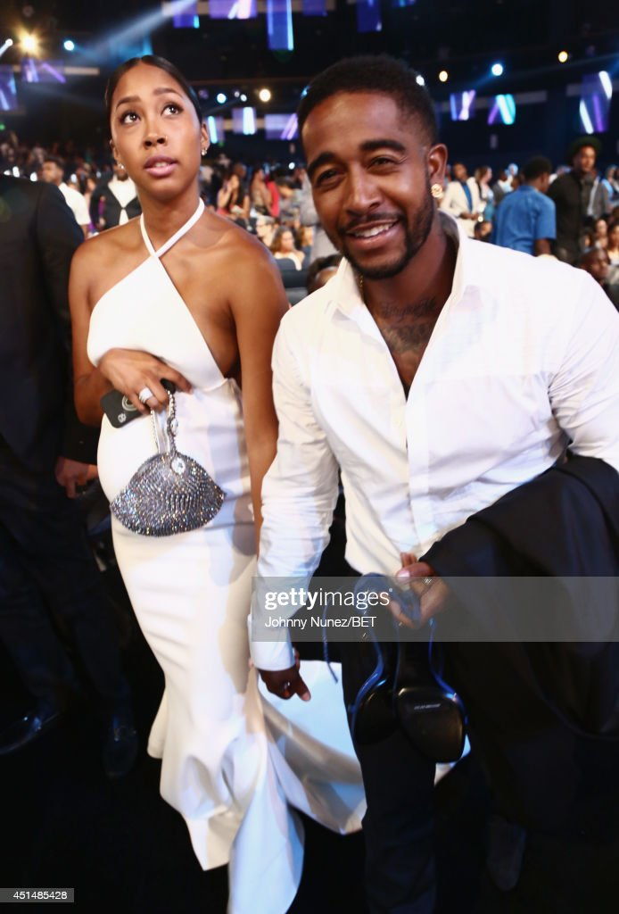 Singers Omarion (R) and Apryl Jones pose in the audience at the BET AWARDS '14 at Nokia Theatre L.A. LIVE on June 29, 2014 in Los Angeles, California.