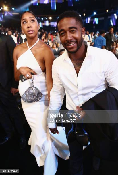 Singers Omarion and Apryl Jones pose in the audience at the BET AWARDS '14 at Nokia Theatre LA LIVE on June 29 2014 in Los Angeles California