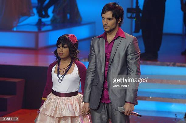 Singers Patricia and Agustin perfroms during the fourth concert of the reality show La Academia of TV Azteca at Churubusco Studios on October 25 2009...