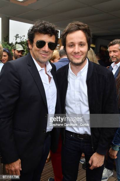 Singers Patrick Bruel and Vianney attend the Men Final of the 2018 French Open Day Fithteen at Roland Garros on June 10 2018 in Paris France