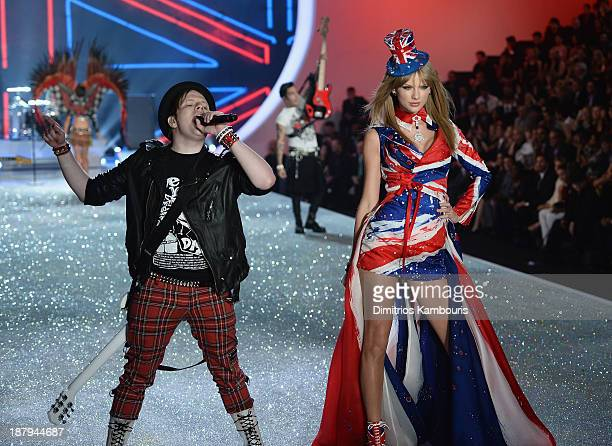 Singers Patrick Stump of the band Fall Out Boy and Taylor Swift perform at the 2013 Victoria's Secret Fashion Show at Lexington Avenue Armory on...