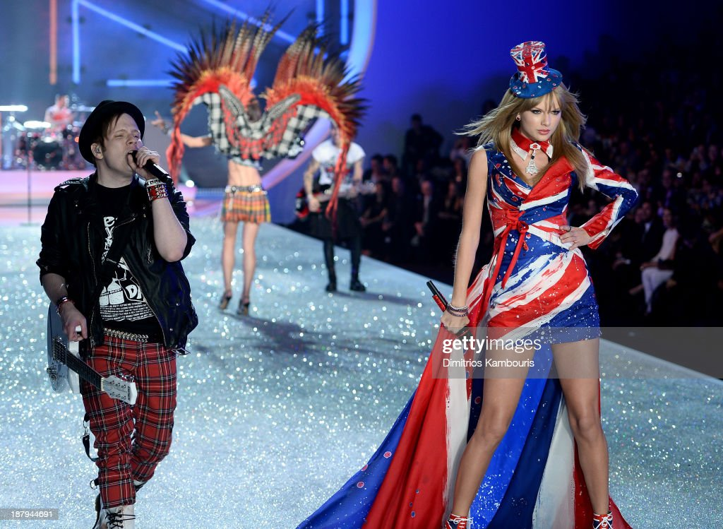 Singers Patrick Stump (L) of the band Fall Out Boy and Taylor Swift perform at the 2013 Victoria's Secret Fashion Show at Lexington Avenue Armory on November 13, 2013 in New York City.