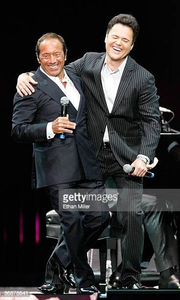 Singers Paul Anka and Donny Osmond perform the song Puppy Love together for the first time onstage during the Hit Man David Foster and Friends...
