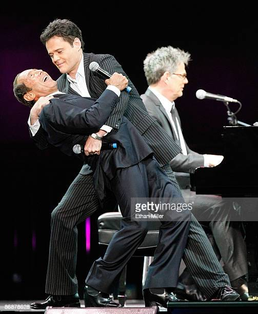 Singers Paul Anka and Donny Osmond sing the song Puppy Love together for the first time onstage as producer/composer David Foster performs during the...