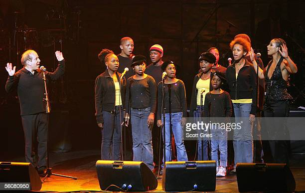 Singers Paul Simon and Alicia Keys perform with the Agape Children's Choir onstage at the Keep a Child Alive Annual Fundraiser 'The Black Ball' at...