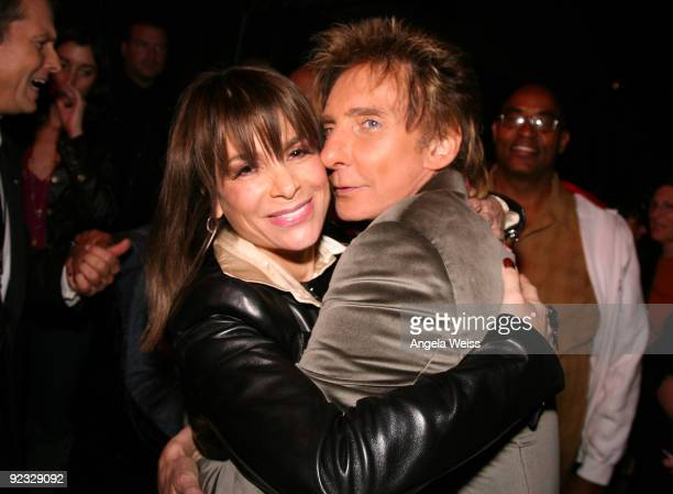 Singers Paula Abdul and Barry Manilow attend Barry Manilow's concert after party at the Hollywood Bowl on October 24 2009 in Hollywood California