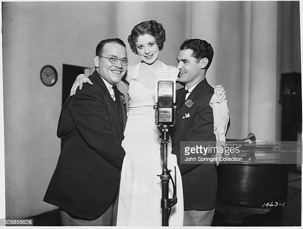 Singers Pee Wee Hunt and Kenny Sargent hold up fellow radio star Annette Hanshaw. The trio were regulars on CBS's Camel Caravan radio show during the...