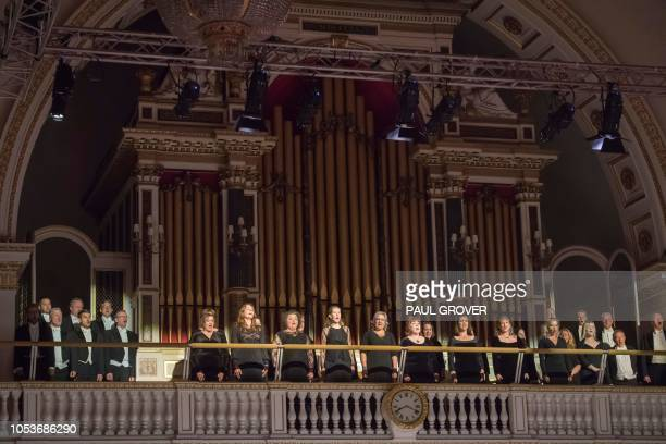 Singers perform in the organ loft of the Throne Room at Buckingham Palace in London on October 25 to mark 70th birthday of Britain's Prince Charles...