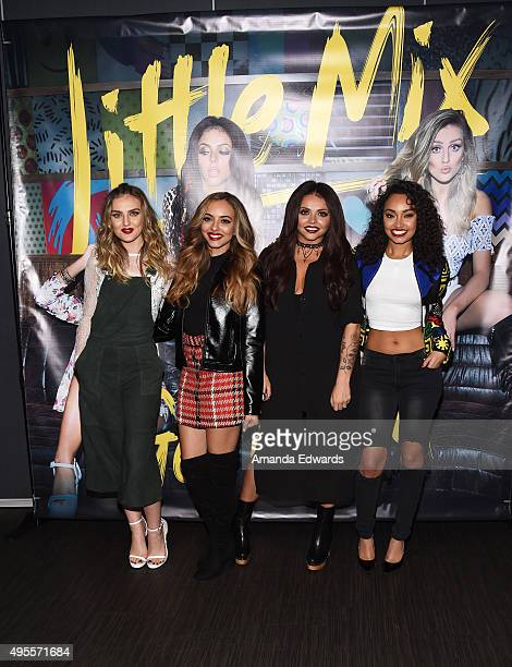 Singers Perrie Edwards, Jade Thirlwall, Jesy Nelson and Leigh-Anne Pinnock of the girl band Little Mix pose before performing onstage and signing...