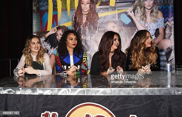 Singers Perrie Edwards LeighAnne Pinnock Jesy Nelson and Jade Thirlwall of the girl band Little Mix sign copies of the band's album at the Hard Rock...