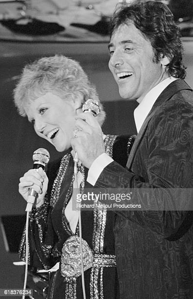 Singers Petula Clark and Sacha Distel perform on the French television show Numero Un Clark was best known for her 1964 hit song Downtown which was...
