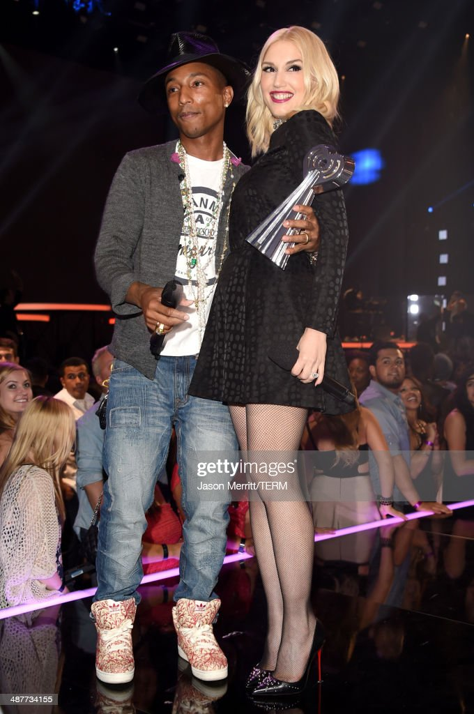 Singers Pharrell Williams (L) and Gwen Stefani appear backstage at the 2014 iHeartRadio Music Awards held at The Shrine Auditorium on May 1, 2014 in Los Angeles, California. iHeartRadio Music Awards are being broadcast live on NBC.
