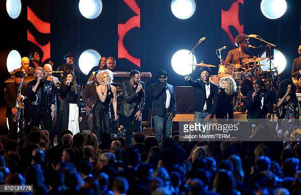 Singers Philip Sweet Karen Fairchild Kimberly Schlapman and Jimi Westbrook of Little Big Town perform onstage with Pharrell Williams and The Roots at...