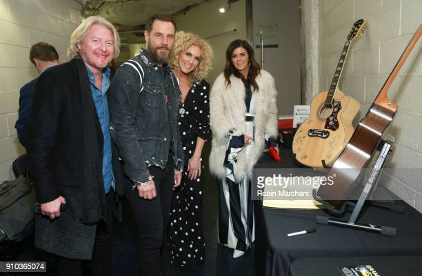 Singers Phillip Sweet Jimi Westbrook Kimberly Schlapman and Kimberly Schlapman of musical group Little Big Town with the GRAMMY Charities Signings...