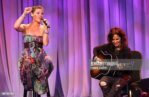Singers Pink and Linda Perry perform at the LA Gay Lesbian Center's An Evening With Women on May 1 2010 in Beverly Hills California