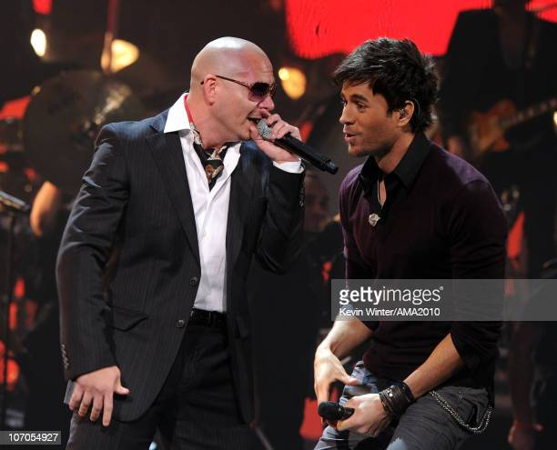 Singers Pitbull and Enrique Iglesias perform onstage during the 2010 American Music Awards held at Nokia Theatre LA Live on November 21 2010 in Los...
