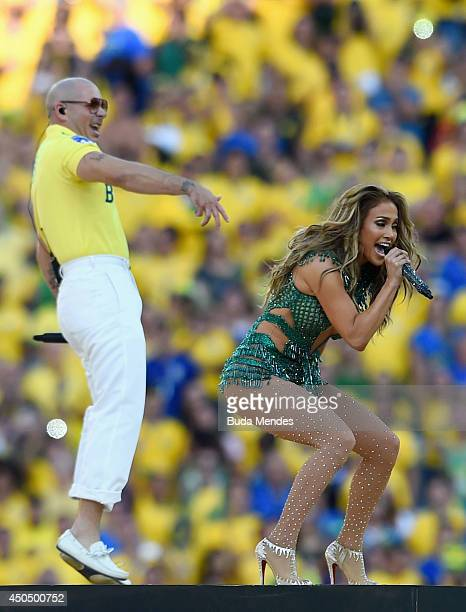 Singers Pitbull and Jennifer Lopez perform during the Opening Ceremony of the 2014 FIFA World Cup Brazil prior to the Group A match between Brazil...