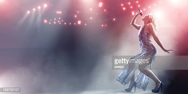 singer's powerful stage performance - singer stock pictures, royalty-free photos & images