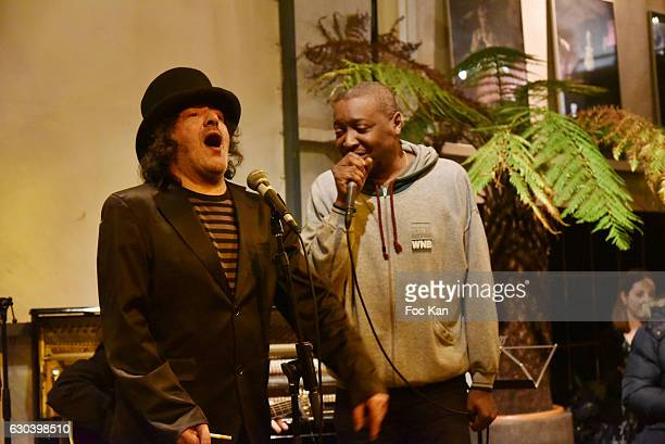 Singers Rachid Taha and Idriss Bass perform during the 'Back in 1966' Concert at La Bellevilloise on December 21 2016 in Paris France