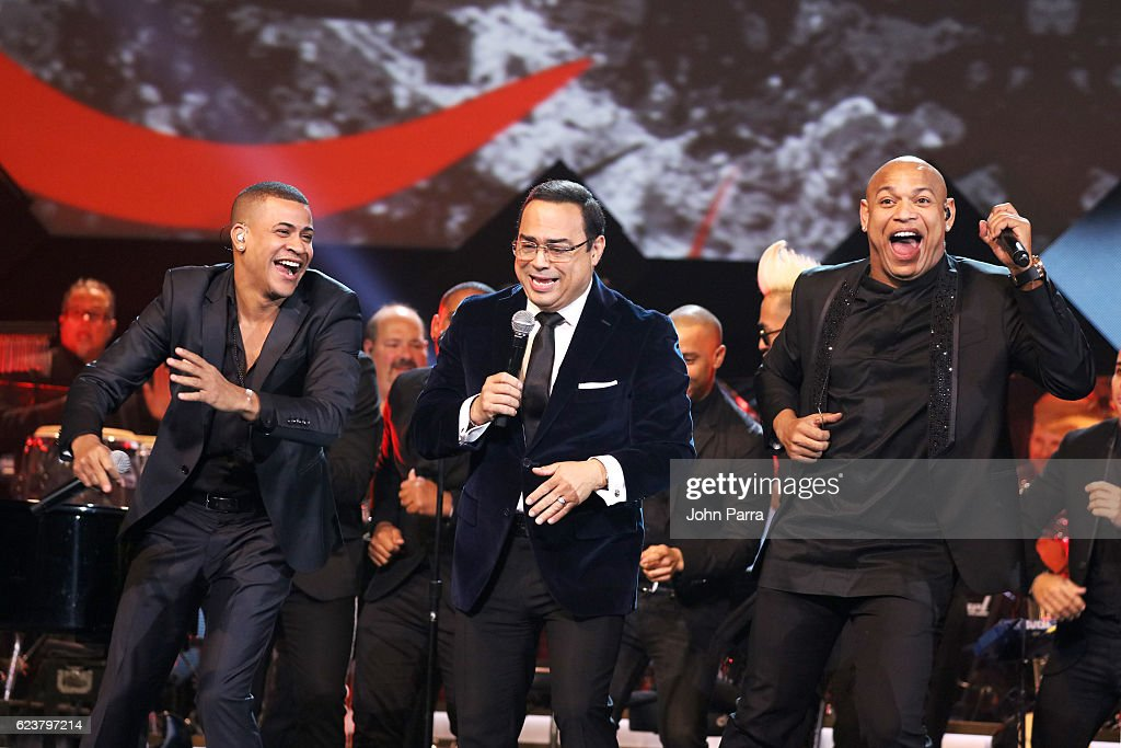 Singers Randy Malcom (L) and Alexander Delgado (R) of Gente de Zona with Gilberto Santa Rosa (C) perform onstage during the 2016 Person of the Year honoring Marc Anthony at MGM Grand Garden Arena on November 16, 2016 in Las Vegas, Nevada.