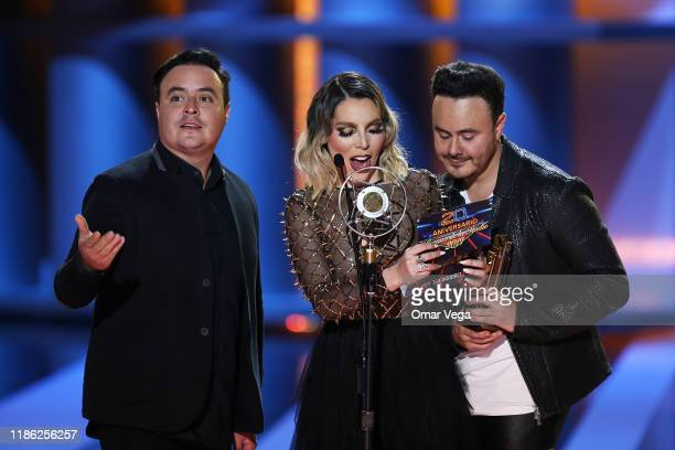 Singers Raul Roma of Rio Roma Frida Sofia and Jose Luis Ortega of Rio Roma present the award winner of 'Corrido del año' during Premios de la Radio...