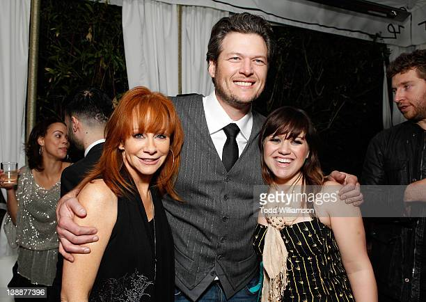 Singers Reba McEntire Blake Shelton and Kelly Clarkson attend the Warner Music Group Grammy Celebration hosted by InStyle Editor Ariel Foxman at the...