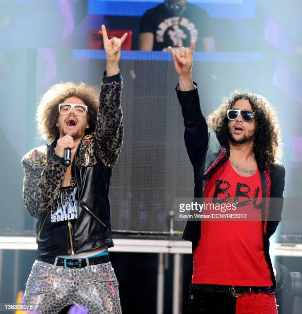 Singers Redfoo and SkyBlu of LMFAO perform on Dick Clark's New Year's Rockin' Eve at Los Angeles Center Studios on December 31 2011 in Los Angeles...