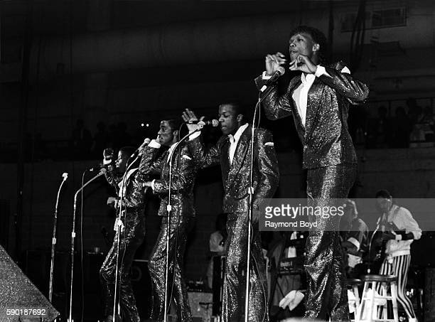 Singers Ricky Bell Ralph Tresvant Michael Bivins and Ronnie DeVoe from New Edition performs at the UIC Pavilion in Chicago Illinois in January 1985