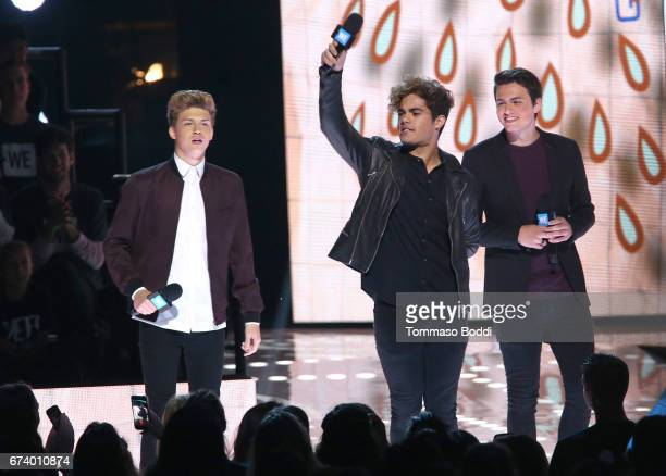 Singers Ricky Garcia, Emery Kelly and Liam Attridge of Forever In Your Mind speak onstage at WE Day California to celebrate young people changing the...