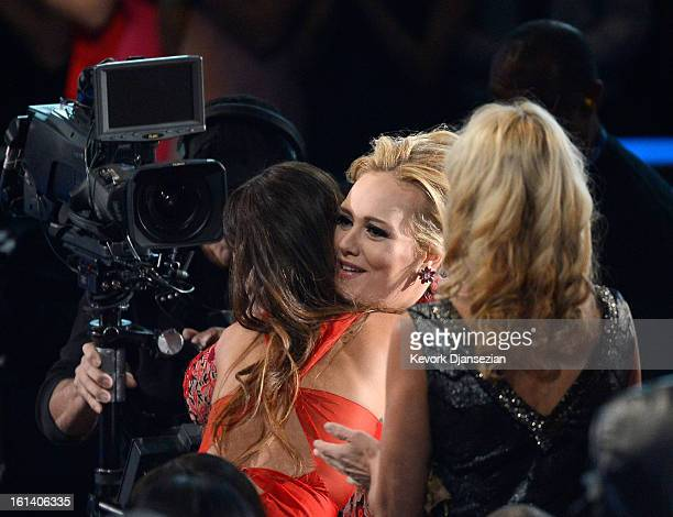 Singers Rihanna and Adele embrace at the 55th Annual GRAMMY Awards at Staples Center on February 10 2013 in Los Angeles California