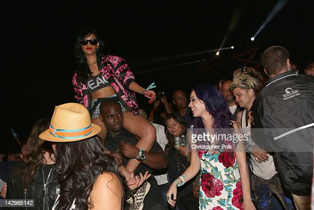 Singers Rihanna and Katy Perry in the audience during day 3 of the 2012 Coachella Valley Music Arts Festival at the Empire Polo Field on April 15...
