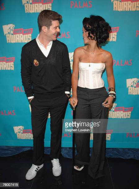 """Singers Robin Thicke and Rihanna during MTV's """"TRL"""" announcing the nominations for the 2007 MTV Video Music Awards at MTV Studios in Times Square on..."""