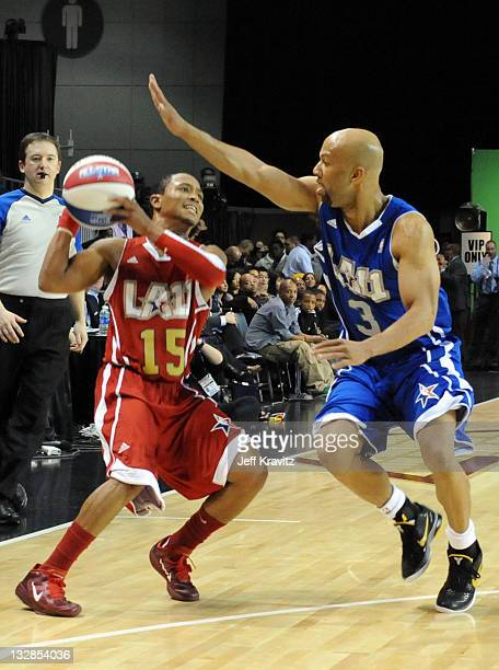 Singers Romeo Miller and Common during the 2011 BBVA NBA All-Star Celebrity Game at Los Angeles Convention Center on February 18, 2011 in Los...